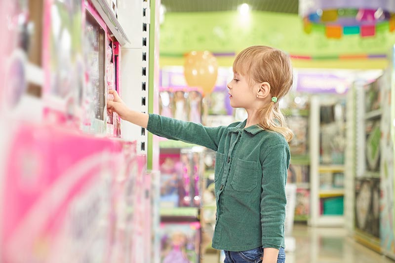 id choosing toys for purchase in big store.
